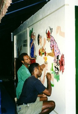 Vanuatu artists work on a painting